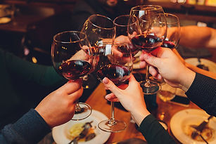 close-up-shot-group-people-clinking-glas