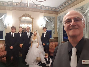 White Wedding Party and Celebrant selfie