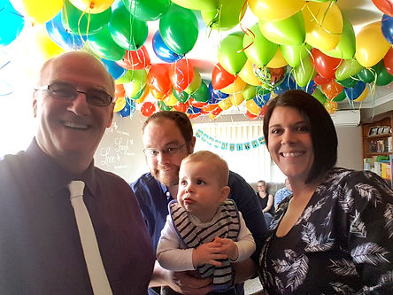 Mum, Dad and Baby at a naming ceremony