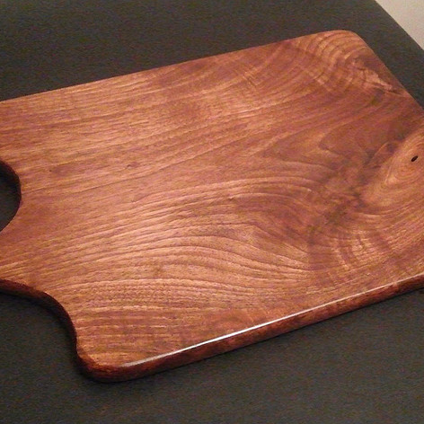 Handled black walnut cutting board