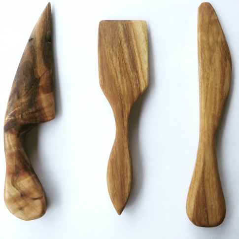 Hand carved wooden cheese knives