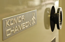 Logo of Komori-chambon on a machine