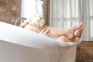 Person enjoying a warm bath