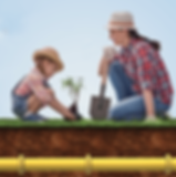 Mom and daughter planting a tree with gas pipeline below
