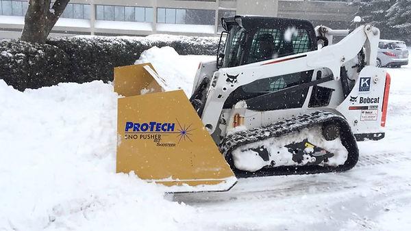 skid pushing snow.jpg