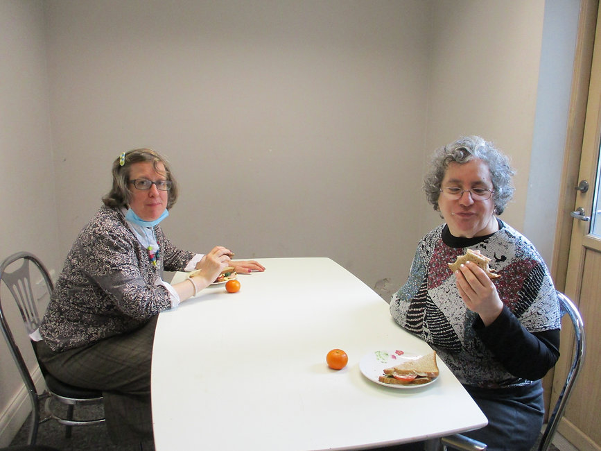 young ladies with learning disabilities eating nutritious lunch