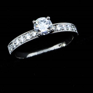 4 claw diamond engagement ring with grain set shoulder diamonds