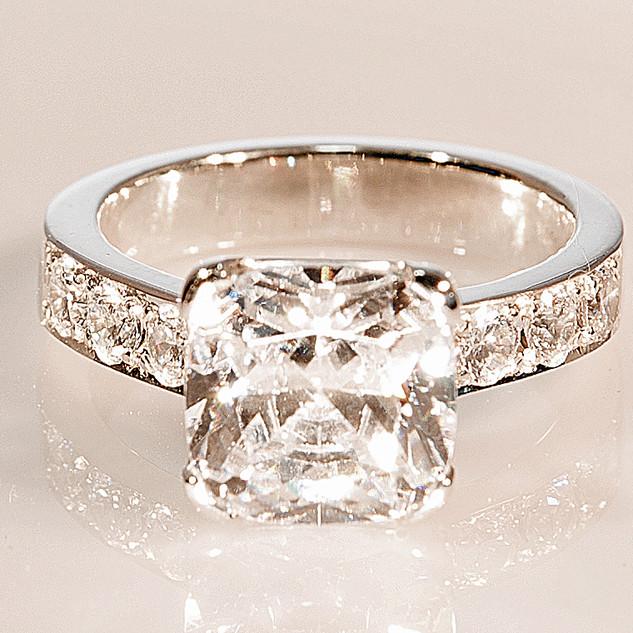 Platinum and diamond engagement ring with bead grain setting shoulder diamonds