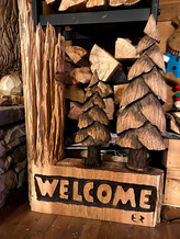 Chainsaw carve welcome sign