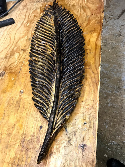 Chainsaw carve feather