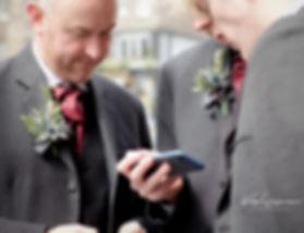 Groomsmen and phone Edinburgh Wedding Photographer
