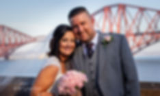 bride and groom in front of forth rail bridge