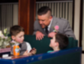 groom talking to pageboys