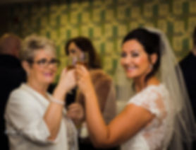 bride and mum with champagne