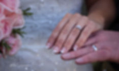 bride and groom wedding rings on hands