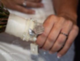bride hand on bouquet with tribute to gran