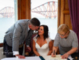 bride and groom signing registar
