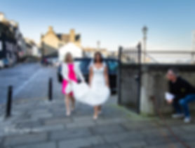 bride walking on pavement