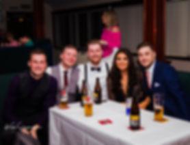 wedding guests smiling at camera