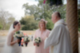 Bride chatting to priest Kate Stevenson Photography