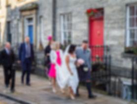 bridal party walking down street