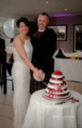 Cutting Cake Edinburgh Wedding Photographer