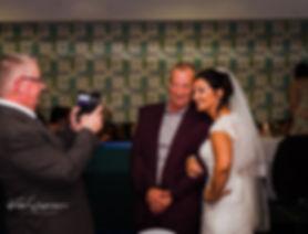 bride getting picture taken