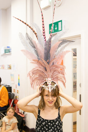 We got to try on real headdresses from the Carnival