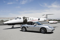 View of a convertible and private jet on