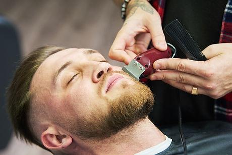 beard-care-man-while-trimming-his-facial