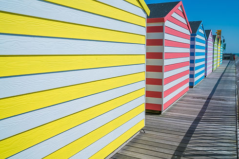 Colorful wooden huts on Hastings pier.jp
