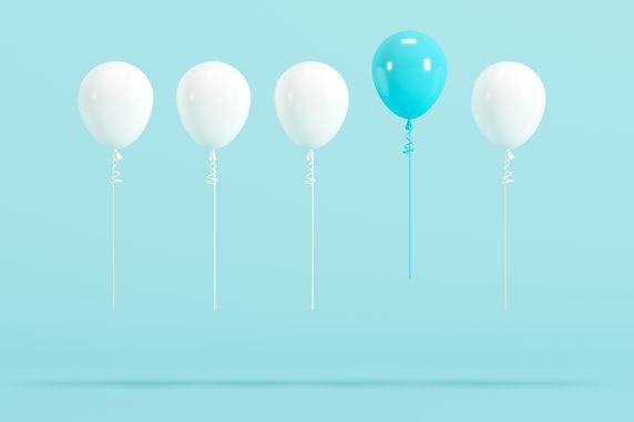 outstanding blue balloon among white bal