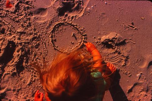 M beach drawing in sand.jpg