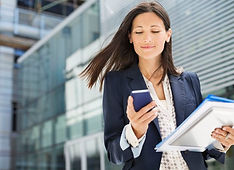 businesswoman-using-cell-phone-in-office