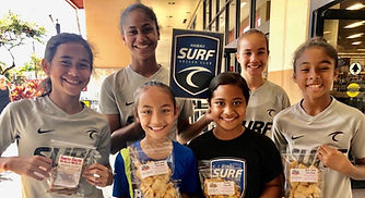 Group of Girls holding Snacks Galore Hawaii Fundraising Products