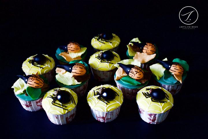 Orange Hercules Beetles & Black Widow Spiders Cupcakes