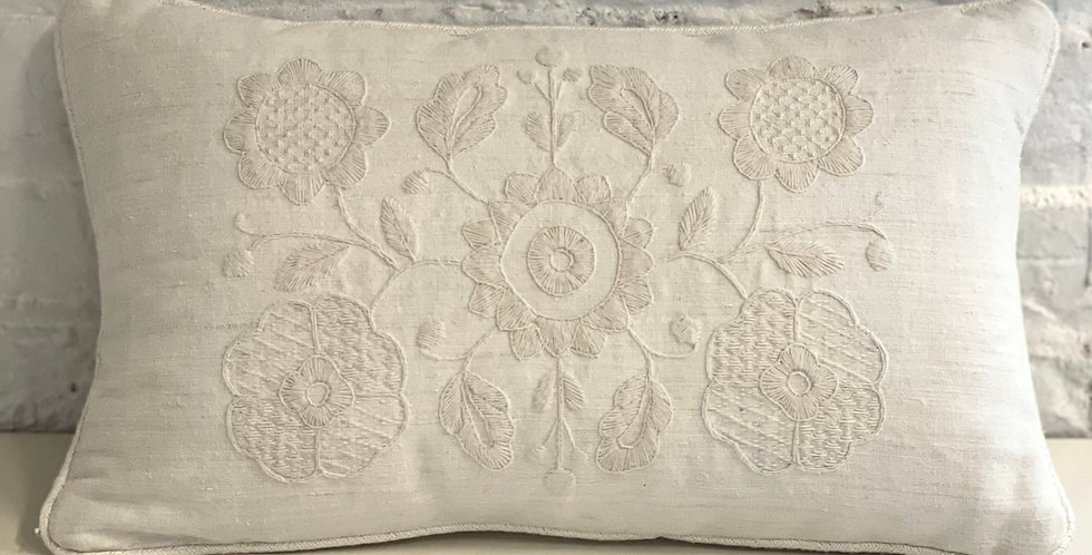 Handmade decorative linen pillow with floral design