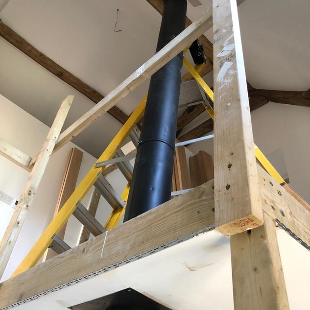 An internal twin wall flue being installed.