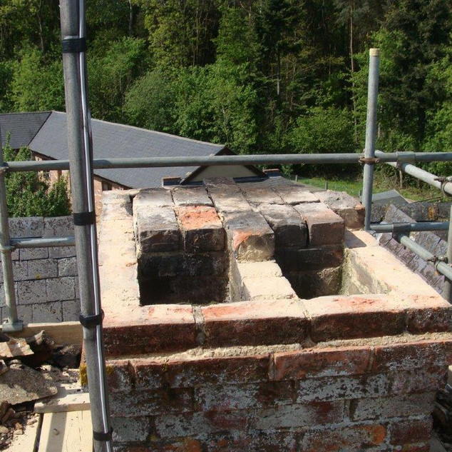 Chimney stack in the process of being rebuilt.
