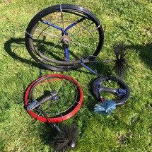 A selection of chimney sweeping reels used to remove fine soot deposits from stainless steel liners.