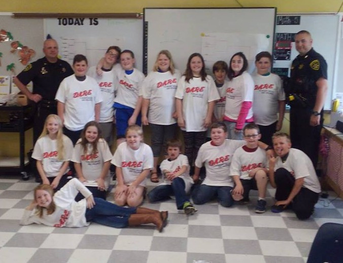 Breck & Deputy Andrew Yessman with a DARE Graduates