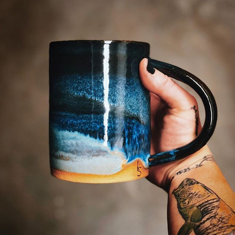 Alright, I wanna hear your most creative description of the glaze on the side of this mug.