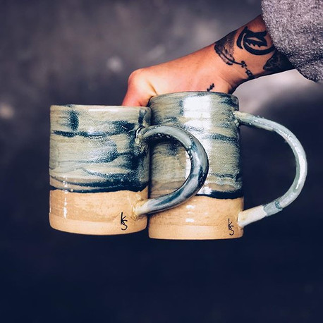 An odd pair, eh_ I made these mugs last year and re-glazed them today. Had to spice'em up