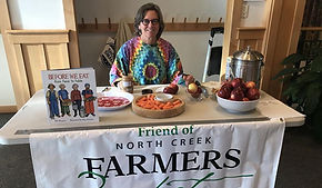 Market Director sitting at an informational table