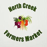 Logo of North Creek Farmers Market: company name surrounding small bushel of illustrated vegetables