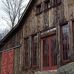 Side of a large barn with red door