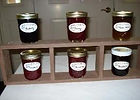6 jars of jelly on a small shelf display
