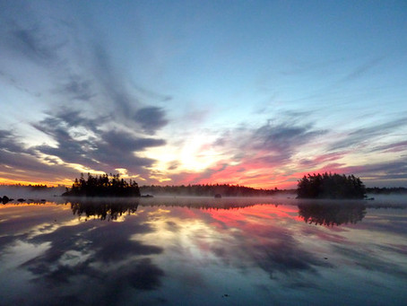 I must have a thousand photos of sunrise over the lake
