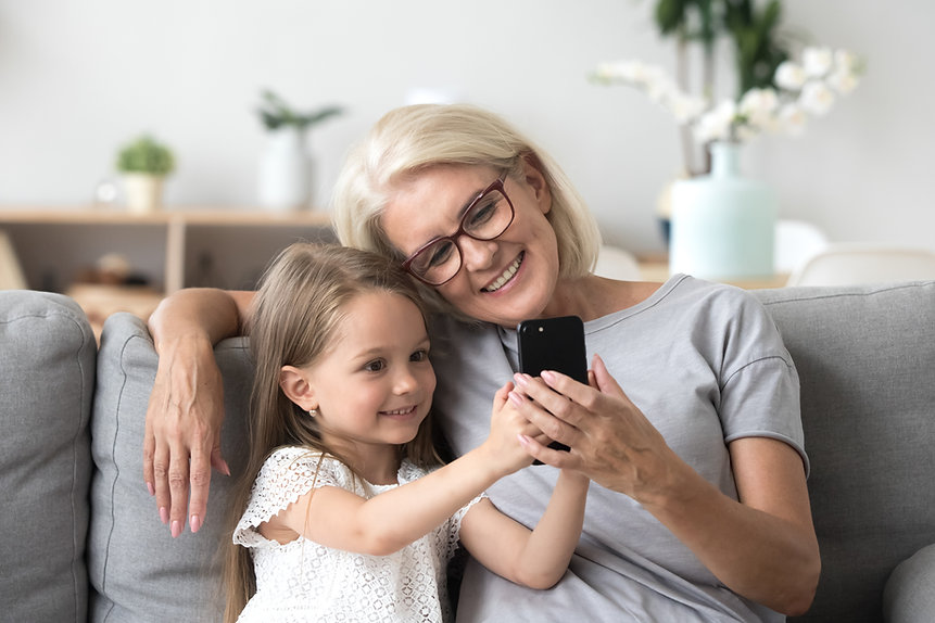 Happy grandmother and cute granddaughter