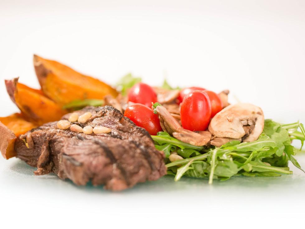 steak, sweet potato fries, salad